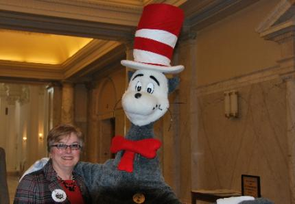Senator King poses with The Cat in the Hat on Read Across America Day