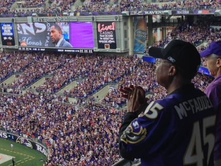 Senator McFadden watching Ray Lewis's induction into the Ravens Ring of Honor