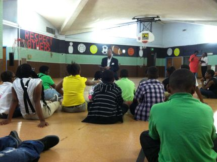Senator McFadden reading at a Harambee! program at Collington Square